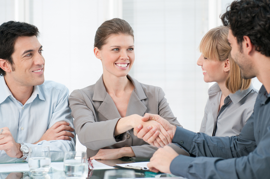 Happy smiling businesswoman shaking hands after a business meeting